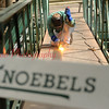 An employee with Knoebels Amusement works on a pedestrian bridge on Friday, Sept. 16.