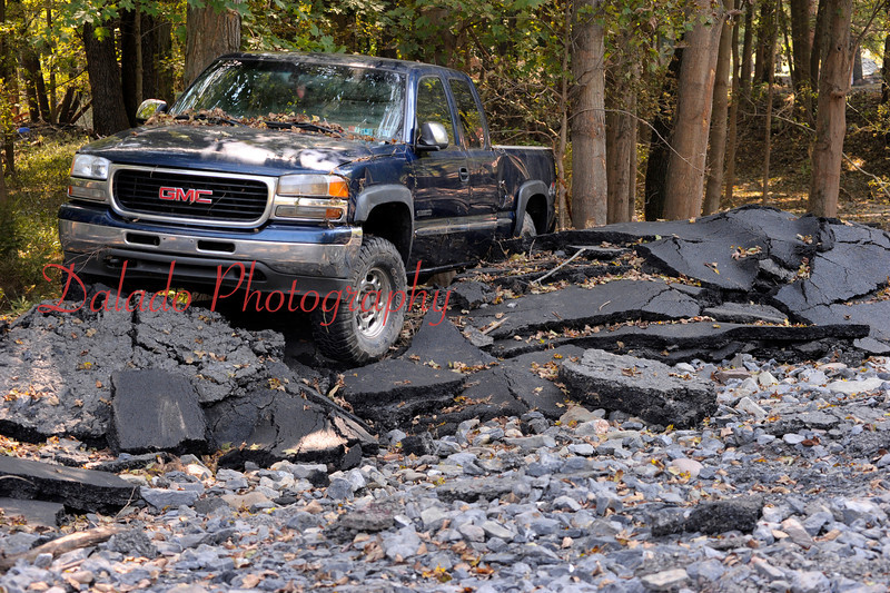 A truck near Winding Road that got washed away from a residence.