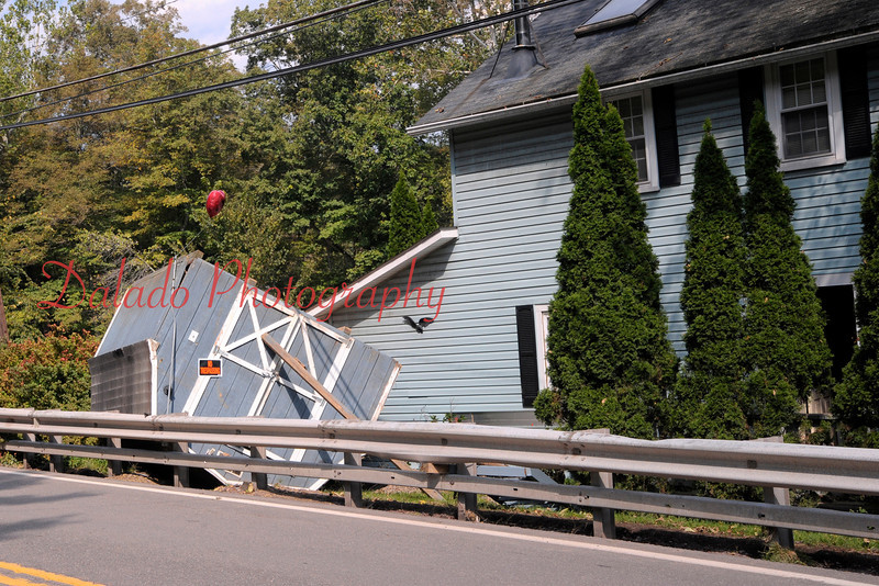 A flipped shed at a home along Fishing Creek.