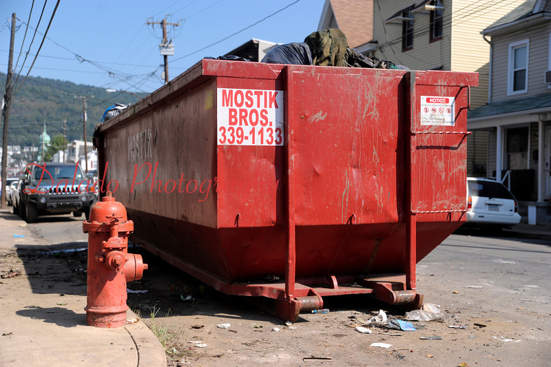 A dumpster parked on Shamokin Street in the 5th Ward of Shamokin.