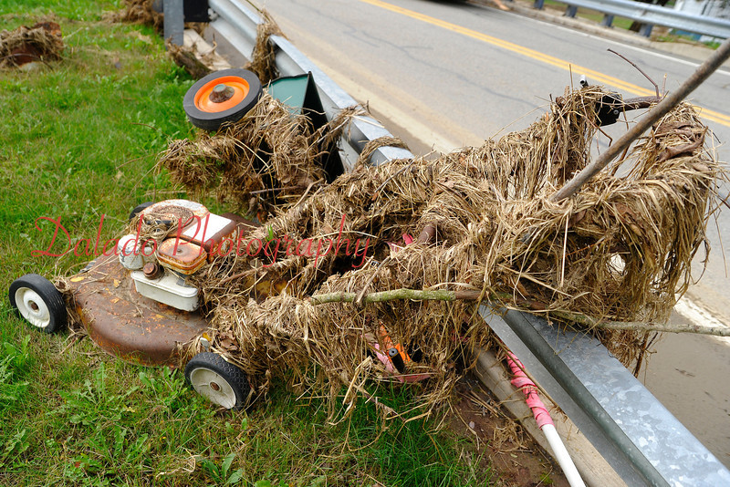 A debris-covered lawn mower along Urban Road in Mandata.