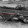 (10.11.1976) Two youngsters watch the swirling water from a railroad bridge in Shamokin during a flash flood.