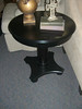 dark round end table