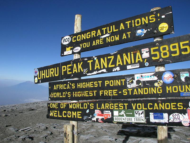 Uhuru Peak, 5895m summit Kili and in the background Mnt. Meru