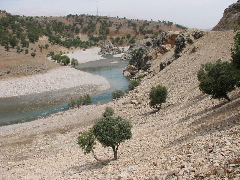 river with scree hills