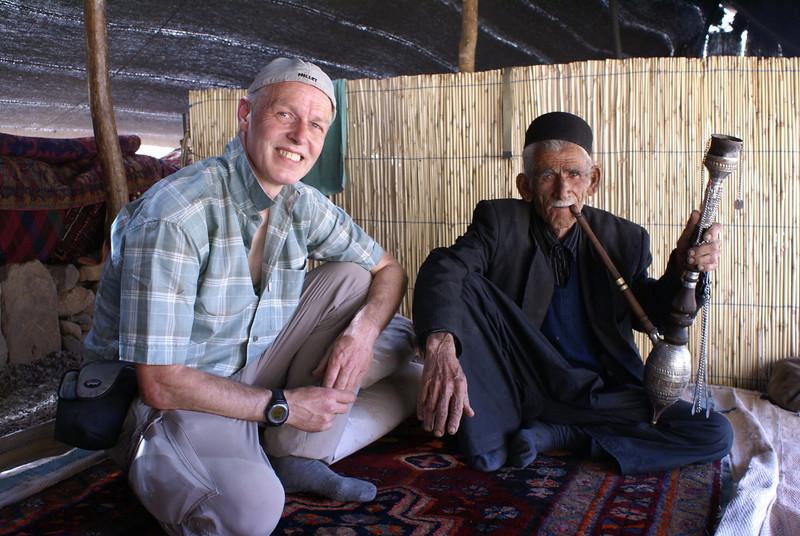 nomad smoking a qalyan (water pipe)
