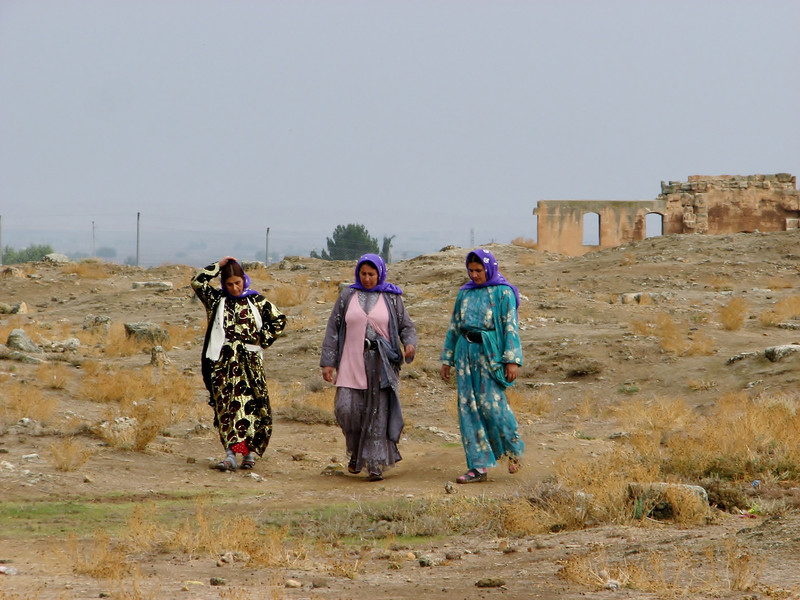 Traditional colourful dressed Kurdish women, Archaeological site, The grand mosque of Harran, S.E. of Sanliurfa near the border of Syria