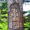 tree with carved figure