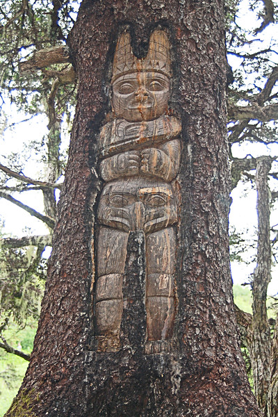 tree trunk with carved figure