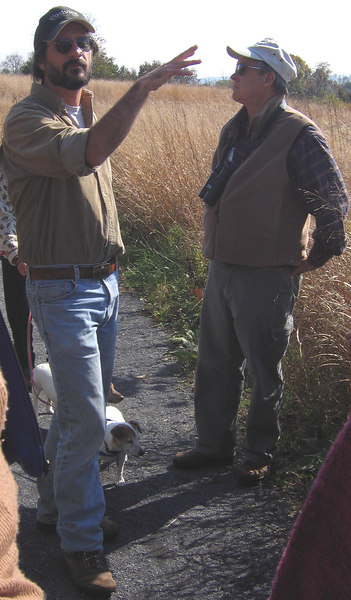 Dave Carr explains the meadow and Bruce Jones listens