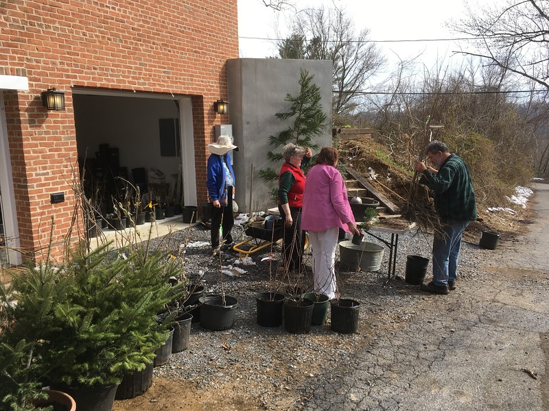 The potting party outside our garage