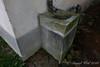Drain sink stuccoed to match house