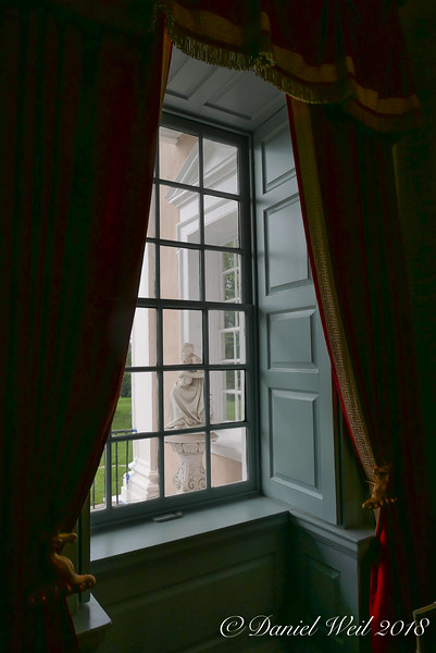 Window treatment; interior shutters opened against window casing