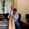 Jim Dronenburg on his harp, in the music conservatory