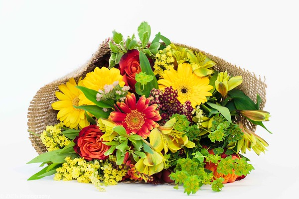 Bouquet of fall colors wrapped in burlap