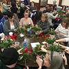 Tables full of budding florists carefully crafted their holiday arrangements. Photo by Mary Leach
