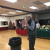 Florist Peter Anthony provided instruction on how to make the perfect holiday arrangement. Photo by Mary Leach