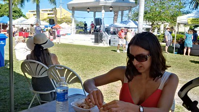 Digging into some whole shrimp while listening to a band at the Key West Seafood Festival.
