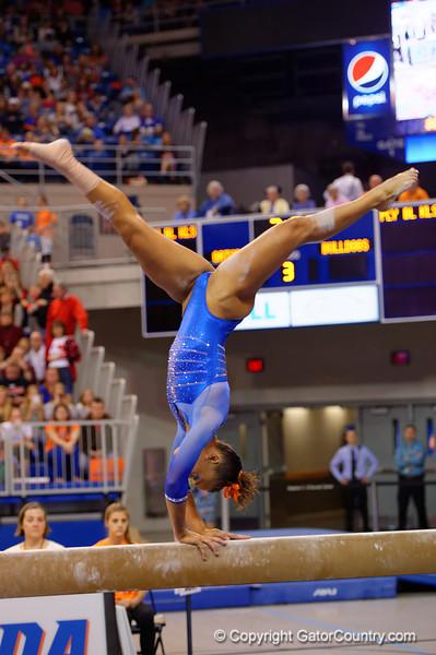 Florida Gators gymnast Kytra Hunter performs on the balance beam.  Florida Gators Gymnastics vs Georgia Bulldogs.  January 30th, 2015. Gator Country photo by David Bowie.