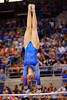 Florida Gators gymnast Rachel Spicer performs her uneven bars routine.  Florida Gators Gymnastics vs Georgia Bulldogs.  January 30th, 2015. Gator Country photo by David Bowie.