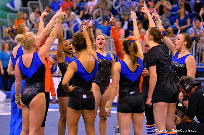 The Florida Gators gather together before the start of the meet against Georgia.  Florida Gators Gymnastics vs Georgia Bulldogs.  January 30th, 2015. Gator Country photo by David Bowie.