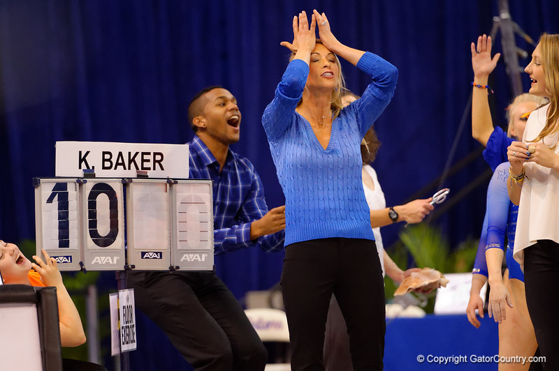 Florida Gators head coach Rhonda Faehn reacts after finding out gymnast Kennedy Baker barely missed a perfect 10, scoring a 9.975.  Florida Gators Gymnastics vs Georgia Bulldogs.  January 30th, 2015. Gator Country photo by David Bowie.
