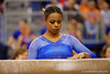 Florida Gators gymnast Kennedy Baker prepares to perform on the balance beam.  Florida Gators Gymnastics vs Georgia Bulldogs.  January 30th, 2015. Gator Country photo by David Bowie.