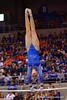 Florida Gators gymnast Claire Boyce performs her uneven bars routine.  Florida Gators Gymnastics vs Georgia Bulldogs.  January 30th, 2015. Gator Country photo by David Bowie.