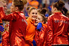 The Florida Gators celebrate their win of the Georgia Bulldogs.  Florida Gators Gymnastics vs Georgia Bulldogs.  January 30th, 2015. Gator Country photo by David Bowie.