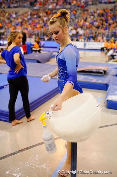 Florida Gators gymnast Claire Boyce chaulks up before performing her balance beam routine.  Florida Gators Gymnastics vs Georgia Bulldogs.  January 30th, 2015. Gator Country photo by David Bowie.
