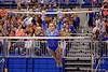 Florida Gators gymnast Bridgette Caquatto performs her uneven bars routine and scores a 9.900.  Florida Gators Gymnastics vs Georgia Bulldogs.  January 30th, 2015. Gator Country photo by David Bowie.