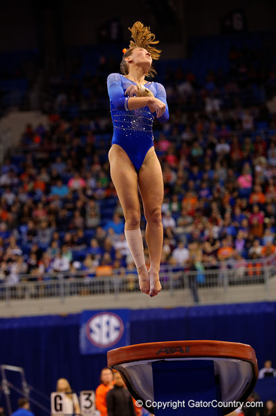 Florida Gators gymnast Kiersten Wang flies through the air during her vault routine.  Florida Gators Gymnastics vs Georgia Bulldogs.  January 30th, 2015. Gator Country photo by David Bowie.
