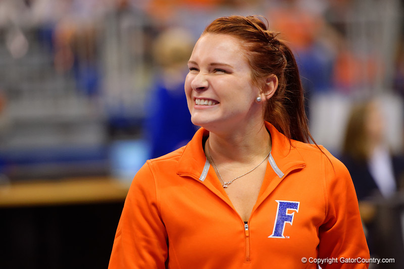 Florida Gators gymnast Bridget Sloan flashes a smile to the crowd as the Gators finish up the uneven bars.   Florida Gators Gymnastics vs Georgia Bulldogs.  January 30th, 2015. Gator Country photo by David Bowie.