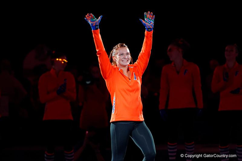 Florida Gators gymnast Bridget Sloan waves to the crowd during player introductions.  Florida Gators Gymnastics vs Georgia Bulldogs.  January 30th, 2015. Gator Country photo by David Bowie.