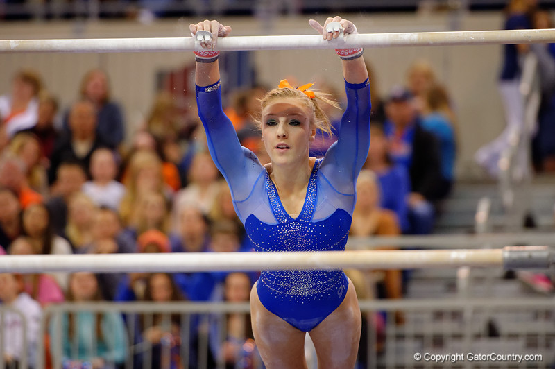 Florida Gators gymnast Alex McMurtry scores a 9.925 on the uneven bars bringing her into a tie for the best score of the night on the uneven bars.  Florida Gators Gymnastics vs Georgia Bulldogs.  January 30th, 2015. Gator Country photo by David Bowie.
