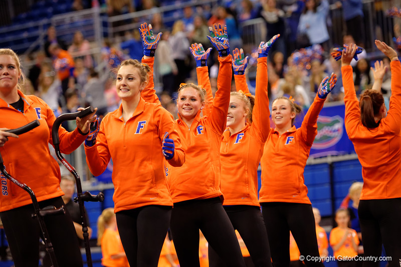 The Florida Gators celebrate their win of the Georgia Bulldogs.  Florida Gators Gymnastics vs Georgia Bulldogs.  January 30th, 2015. Gator Country photo by David Bowie.