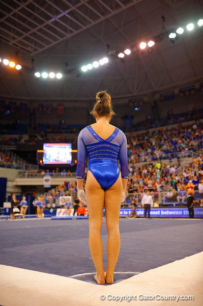 A Florida Gators gymnast prepares to start her floor routine.  Florida Gators Gymnastics vs Georgia Bulldogs.  January 30th, 2015. Gator Country photo by David Bowie.