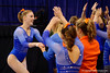 Florida Gators gymnast Alex McMurtry is congratulated by the Gators after her balance beam routine.  Florida Gators Gymnastics vs Georgia Bulldogs.  January 30th, 2015. Gator Country photo by David Bowie.