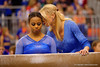 Florida Gators gymnastics head coach Rhonda Faehn leans in to give freshman gymnast Kennedy Baker some words of encouragement before she performs her balance beam routine.   Florida Gators Gymnastics vs Georgia Bulldogs.  January 30th, 2015. Gator Country photo by David Bowie.