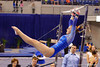 Florida Gators gymnast Bianca Dancose-Giambattisto performs her uneven bars routine.  Florida Gators Gymnastics vs Georgia Bulldogs.  January 30th, 2015. Gator Country photo by David Bowie.