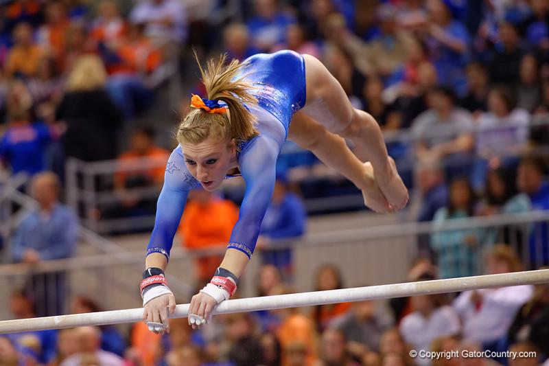 Florida Gators gymnast Alex McMurtry performs her uneven bars routine.  Florida Gators Gymnastics vs Georgia Bulldogs.  January 30th, 2015. Gator Country photo by David Bowie.
