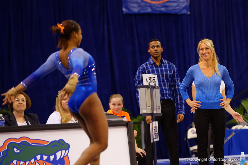 Florida Gators head coach Rhonda Faehn watches on as Florida Gators gymnast Kennedy Baker performs her routine during the floor exercise scoring a 9.975, the highest ever for a Gator freshman.  Florida Gators Gymnastics vs Georgia Bulldogs.  January 30th, 2015. Gator Country photo by David Bowie.