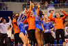 The Gators rush out to congratulate gymnast Kennedy Baker after her floor exercise routine.  The routine would lead to Baker scoring a 9.975, the highest ever by a Gator freshman.  Florida Gators Gymnastics vs Georgia Bulldogs.  January 30th, 2015. Gator Country photo by David Bowie.