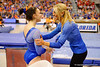 Florida Gators gymnast Ericha Fassbender and Gators head coach Rhonda Faehn share a moment before Fassbender performs her balance beam routine.  Florida Gators Gymnastics vs Georgia Bulldogs.  January 30th, 2015. Gator Country photo by David Bowie.