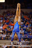 Florida Gators gymnast Kytra Hunter performs on the uneven bars.  Florida Gators Gymnastics vs Georgia Bulldogs.  January 30th, 2015. Gator Country photo by David Bowie.
