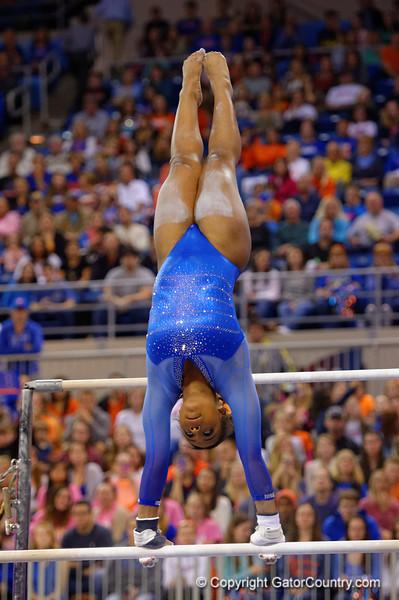 Florida Gators gymnast Kennedy Baker performs her uneven bars routine.  Florida Gators Gymnastics vs Georgia Bulldogs.  January 30th, 2015. Gator Country photo by David Bowie.