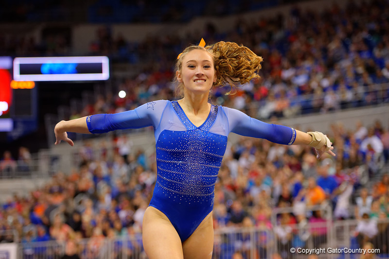 Florida Gators gymnast Kiersten Wang performs her routine during the floor exercise.  Florida Gators Gymnastics vs Georgia Bulldogs.  January 30th, 2015. Gator Country photo by David Bowie.
