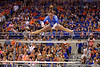 Florida Gators gymnast Bridgette Caquatto performs her uneven bars routine and scores a 9.900.  Florida Gators Gymnastics vs Georgia Bulldogs.  January 30th, 2015. Gator Country photo by David Bowie.