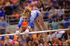 Florida Gators gymnast Alex McMurtry performs her uneven bars routine.  Florida Gators Gymnastics vs Georgia Bulldogs.  January 30th, 2015. Gator Country photo by David Bowie.