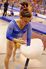 Florida Gators gymnast Ericha Fassbender chaulks up before performing her balance beam routine.  Florida Gators Gymnastics vs Georgia Bulldogs.  January 30th, 2015. Gator Country photo by David Bowie.